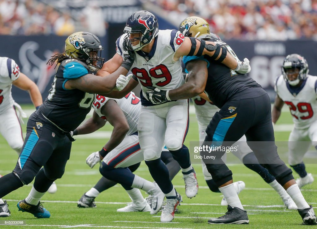J.J. Watt #99 of the Houston Texans is double teamed by A.J. Cann #60 and Jermey Parnell #78 of the Jacksonville Jaguars at NRG Stadium on September 10, 2017 in Houston, Texas.