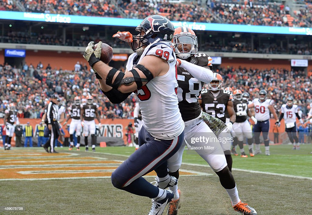 J.J. Watt #99 of the Houston Texans makes a touchdown catch in front of Chris Kirksey #58 of the Cleveland Browns during the first quarter at FirstEnergy Stadium on November 16, 2014 in Cleveland, Ohio.