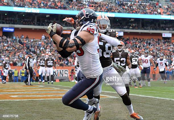 J Watt of the Houston Texans makes a touchdown catch in front of Chris Kirksey of the Cleveland Browns during the first quarter at FirstEnergy...