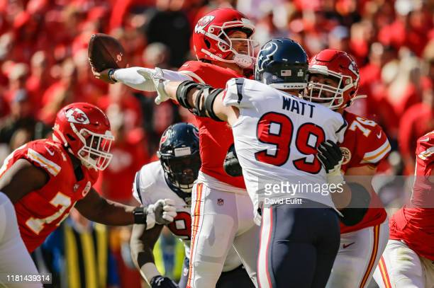 Watt of the Houston Texans pressures Patrick Mahomes of the Kansas City Chiefs over blocking by Laurent Duvernay-Tardif of the Kansas City Chiefs in...