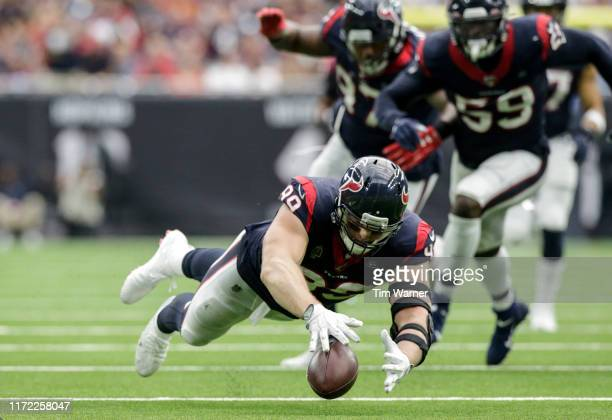 Watt of the Houston Texans recovers a fumble by Kyle Allen of the Carolina Panthers in the third quarter at NRG Stadium on September 29, 2019 in...
