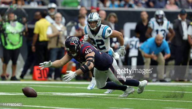 J Watt of the Houston Texans recovers a fumble by Kyle Allen of the Carolina Panthers as Christian McCaffrey looks on during the second half at NRG...