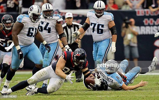 Watt of the Houston Texans recovers a Matt Hasselbeck of the Tennessee Titans fumble in the fourth quarter at Reliant Arena at Reliant Park on...
