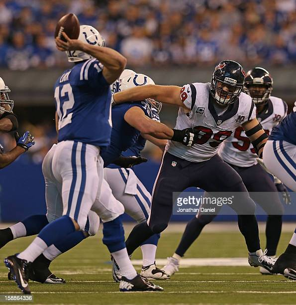 J Watt of the Houston Texans rushes against Mike McGlynn of the Indianapolis Colts as Andrew Luck passes at Lucas Oil Stadium on December 30 2012 in...