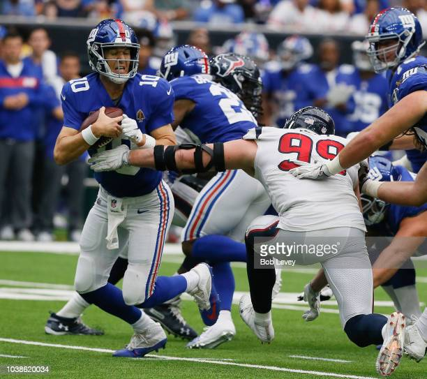 J Watt of the Houston Texans sacks Eli Manning of the New York Giants in the fourth quarter at NRG Stadium on September 23 2018 in Houston Texas