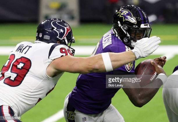 Watt of the Houston Texans sacks Lamar Jackson of the Baltimore Ravens during the first half at NRG Stadium on September 20, 2020 in Houston, Texas.