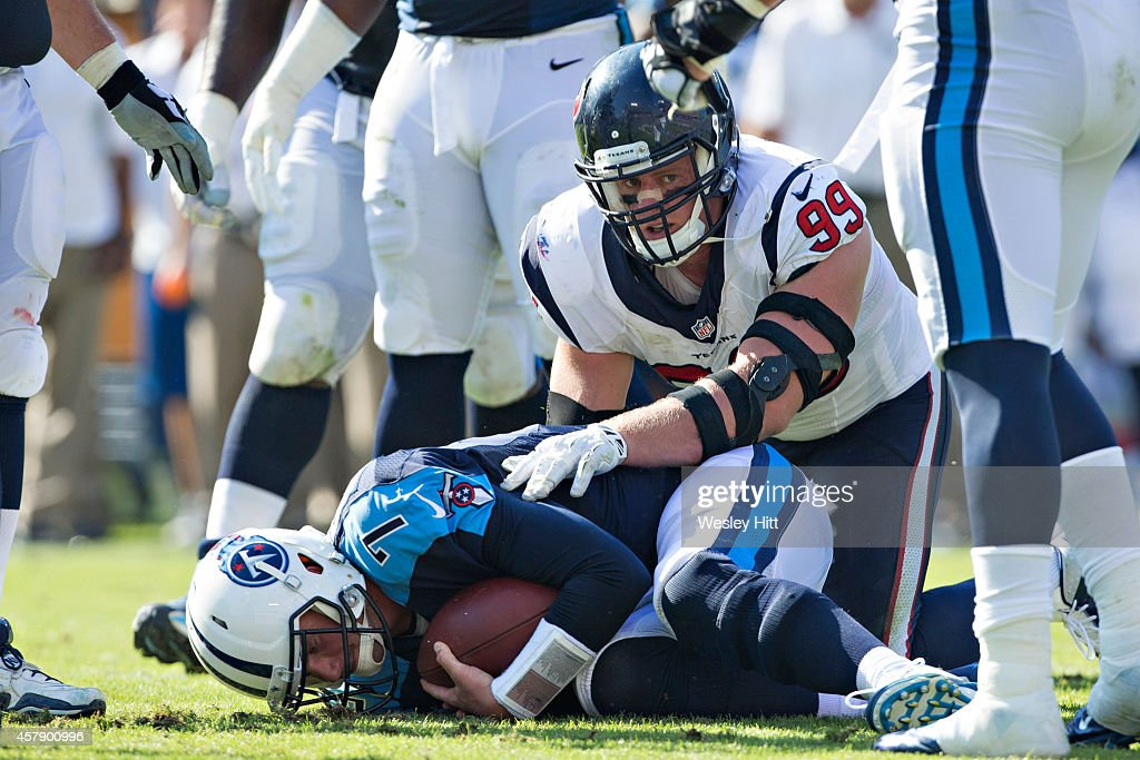 J.J. Watt #99 of the Houston Texans sacks Zach Mettenberger #7 of the Tennessee Titans at LP Field on October 26, 2014 in Nashville, Tennessee. The Texans defeated the Titans 30-16.