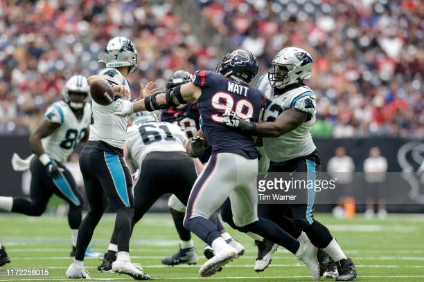 J Watt of the Houston Texans strips the ball from Kyle Allen of the Carolina Panthers in the third quarter at NRG Stadium on September 29 2019 in...