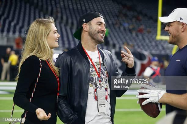 J Watt of the Houston Texans talks iwth Justin Verlander and Kate Upton on the field during pregame activities at NRG Stadium on November 21 2019 in...