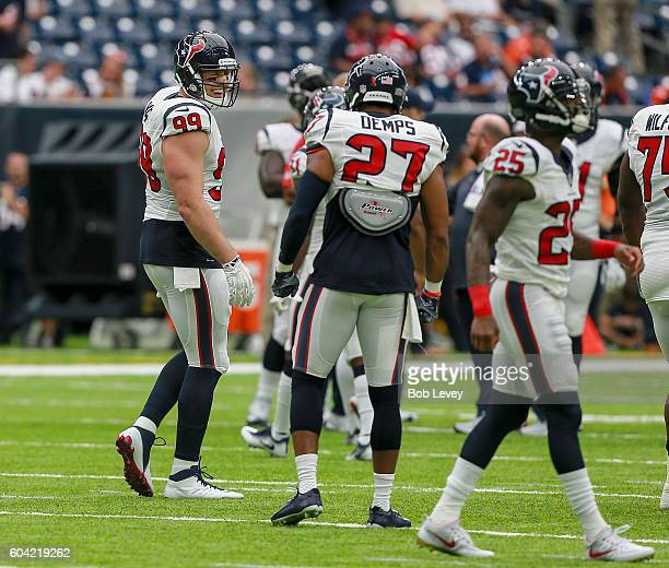 J Watt of the Houston Texans talks with Quintin Demps during warms up before playing the Chicago Bears at NRG Stadium on September 11 2016 in Houston...