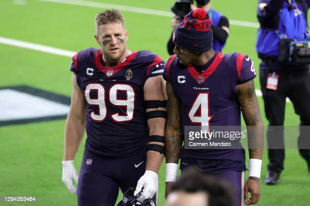 Watt of the Houston Texans walks off the field with Deshaun Watson following a game against the Tennessee Titans at NRG Stadium on January 03, 2021...
