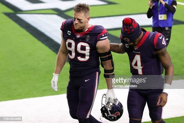 Watt of the Houston Texans walks off the field with Deshaun Watson at NRG Stadium on January 03, 2021 in Houston, Texas.