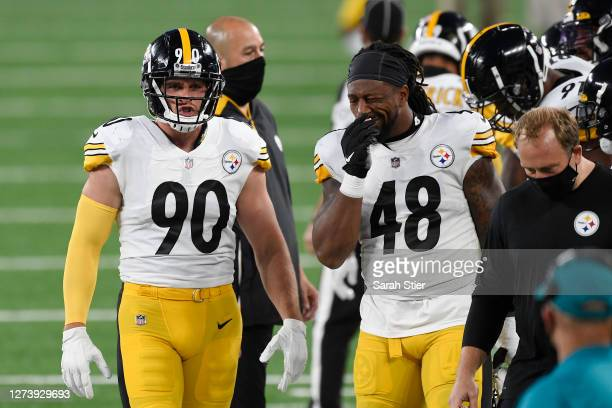 Watt of the Pittsburgh Steelers and Bud Dupree react during the first half against the New York Giants at MetLife Stadium on September 14, 2020 in...
