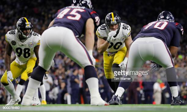 J Watt of the Pittsburgh Steelers and Vince Williams await a snap in the second half against the Houston Texans at NRG Stadium on December 25 2017 in...