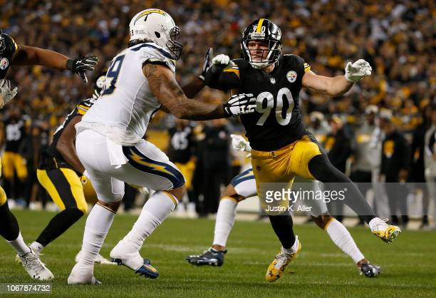 J Watt of the Pittsburgh Steelers attempts to rush the pocket against Sam Tevi of the Los Angeles Chargers in the second half during the game at...