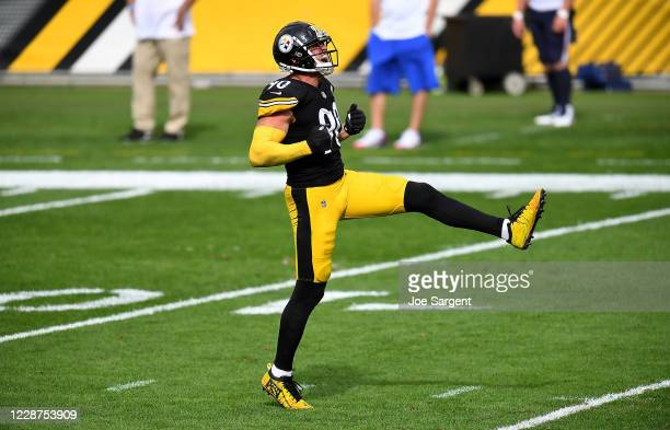 Watt of the Pittsburgh Steelers celebrates after sacking Dustin Colquitt of the Pittsburgh Steelers during the fourth quarter at Heinz Field on...