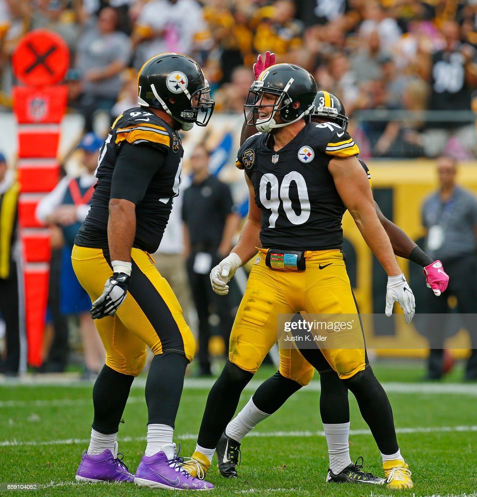 T.J. Watt #90 of the Pittsburgh Steelers celebrates with Cameron Heyward #97 after a defensive stop in the second half during the game against the Jacksonville Jaguars at Heinz Field on October 8, 2017 in Pittsburgh, Pennsylvania.