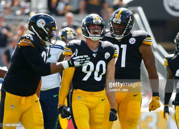 Watt of the Pittsburgh Steelers celebrates with Cameron Heyward and Stephon Tuitt after a sack in the first half against the Seattle Seahawks in the...
