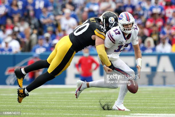 Watt of the Pittsburgh Steelers forces Josh Allen of the Buffalo Bills to fumble during the second quarter at Highmark Stadium on September 12, 2021...