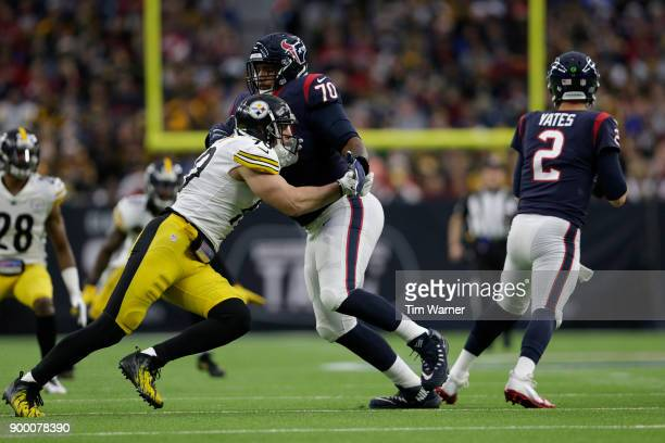 J Watt of the Pittsburgh Steelers is blocked by Julien Davenport of the Houston Texans on his way to pressure TJ Yates in the first half at NRG...