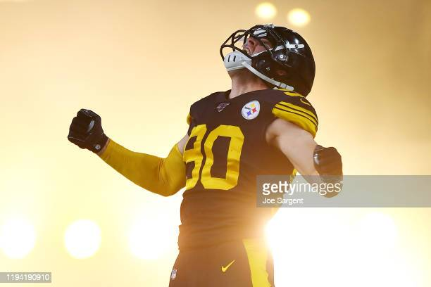 Watt of the Pittsburgh Steelers jumps in the air as he runs onto the field before the game against the Buffalo Bills at Heinz Field on December 15,...