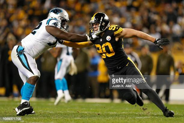 J Watt of the Pittsburgh Steelers rushes the passer against Taylor Moton of the Carolina Panthers during the first half in the game at Heinz Field on...