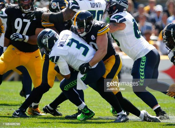 Watt of the Pittsburgh Steelers sacks Russell Wilson of the Seattle Seahawks in the first half on September 15, 2019 at Heinz Field in Pittsburgh,...