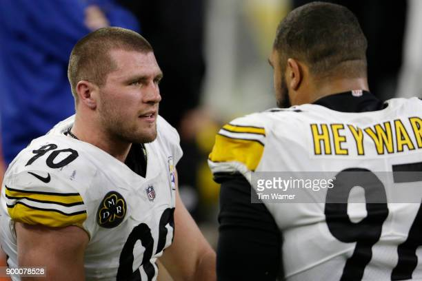 J Watt of the Pittsburgh Steelers talks with Cameron Heyward in the second half against the Houston Texans at NRG Stadium on December 25 2017 in...