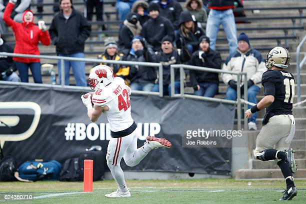J Watt of the Wisconsin Badgers returns an interception 17 yards for a touchdown in the second quarter of the game against the Purdue Boilermakers at...