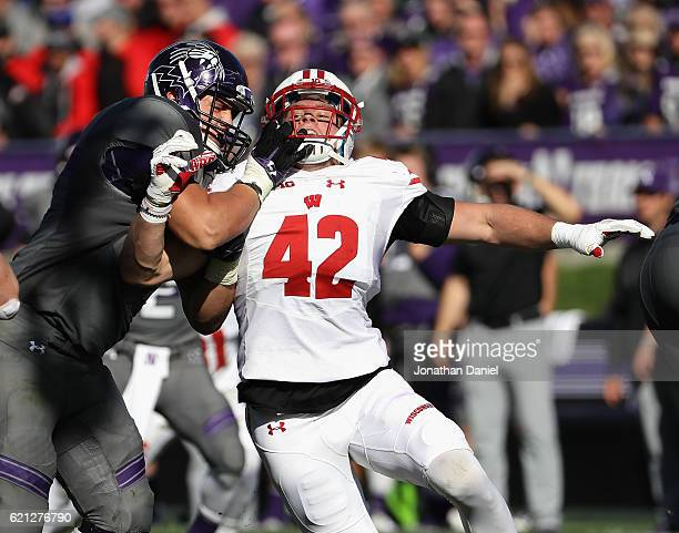 Watt of the Wisconsin Badgers rushes against Tommy Doles of the Northwestern Wildcats at Ryan Field on November 5, 2016 in Evanston, Illinois....