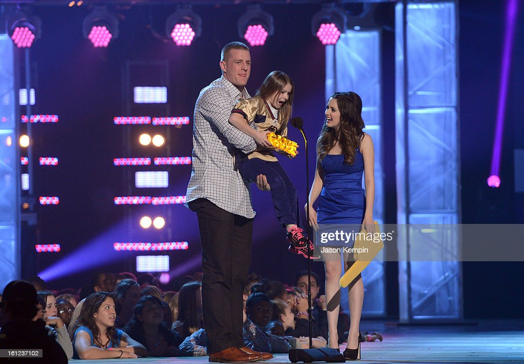 J.J. Watt, Sam Gordon and Laura Marano speak onstage at the Third Annual Hall of Game Awards hosted by Cartoon Network at Barker Hangar on February 9, 2013 in Santa Monica, California. 23270_003_JK_0712.JPG
