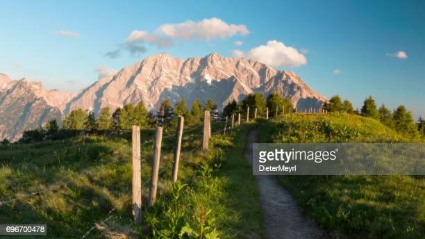 watzmann east wall at sunrise - nationalpark berchtesgaden - berchtesgadener land stock photos and pictures
