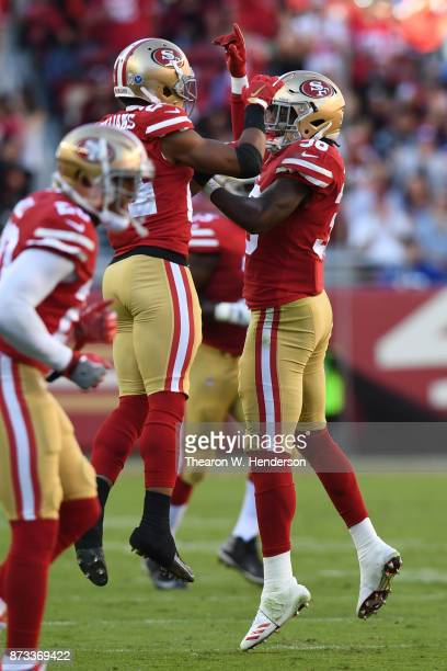Waun Williams and Adrian Colbert of the San Francisco 49ers celebrate after a New York Giants turnover during their NFL game at Levi's Stadium on...