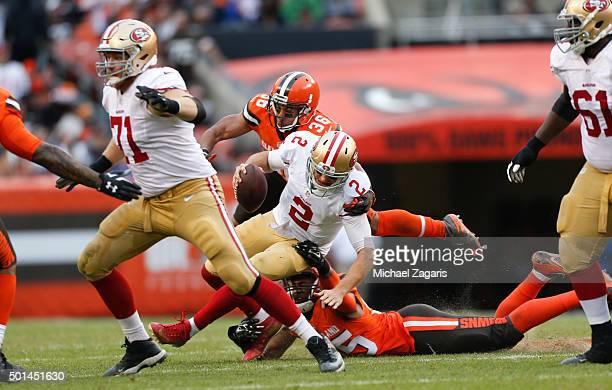 Waun Williams and Armonty Bryant of the Cleveland Browns sack Blaine Gabbert of the San Francisco 49ers during the game at Browns Stadium on December...