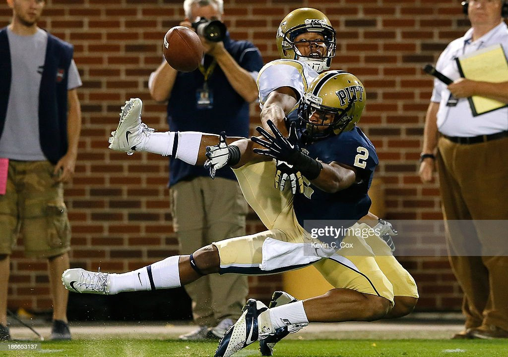 K'Waun Williams #2 of the Pittsburgh Panthers nearly intercepts a pass intended for Darren Waller #88 of the Georgia Tech Yellow Jackets at Bobby Dodd Stadium on November 2, 2013 in Atlanta, Georgia.
