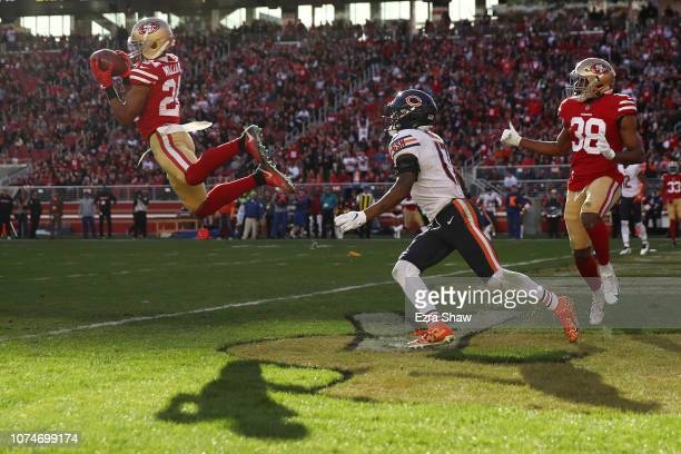 Waun Williams of the San Francisco 49ers intercepts a pass intended for Anthony Miller of the Chicago Bears in the end zone during their NFL game at...