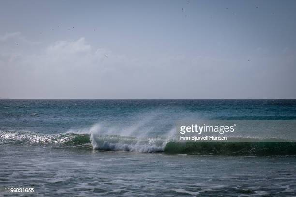 wave at the beach of tarifa, marocco in the background - finn bjurvoll ストックフォトと画像