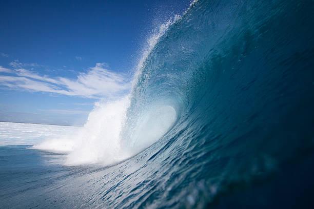 Wave breaking at Cloud Break in Fiji
