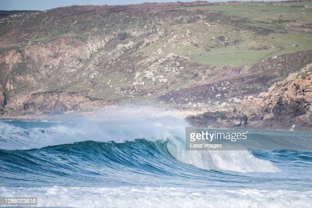 Wave breaking at Sennen Cove in Cornwall.