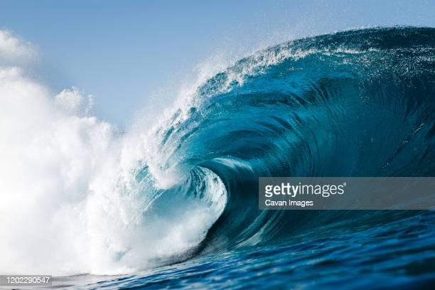 wave breaking on a beach in canary islands - onda foto e immagini stock