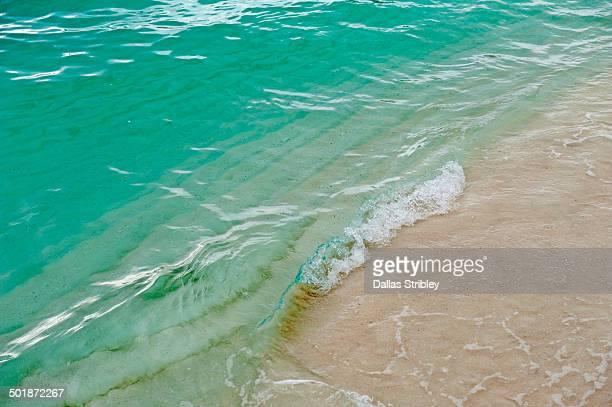 Wave breaking on the beach at Bahia de las Aguilas