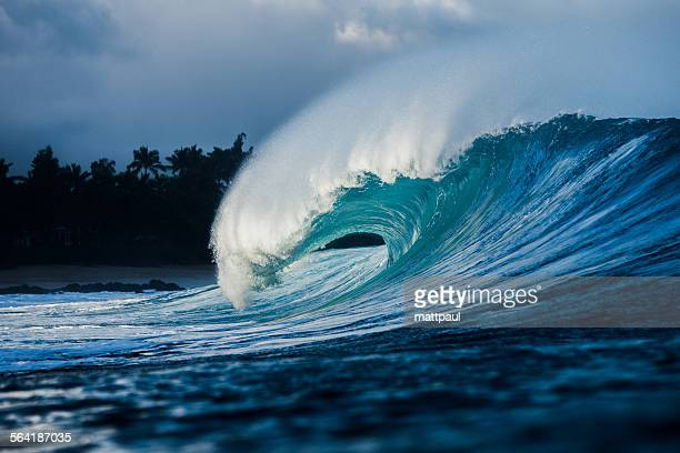 Wave breaking on the reef along the shallow waters, North Shore, Hawaii