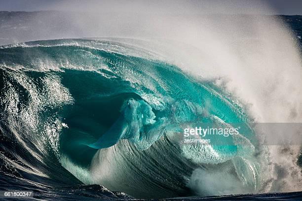 Wave breaking onto shallow reef, Kiama, Australia