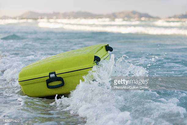 Wave breaking over suitcase