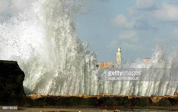 A wave breaks against Havana's Malecon 26 October 2005 damaged after the battering of Huricane Wilma last weekend Although Cuba lies in the path of...