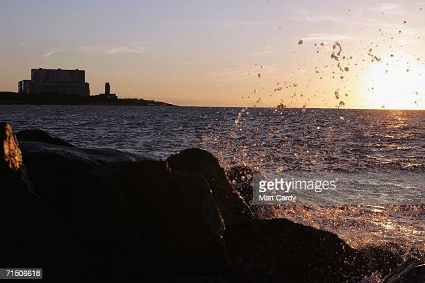 A wave breaks on the rocks close to Hinkley Point Nuclear Power Station are seen on July 17 2006 in Somerset England The Prime Minister Tony Blair...