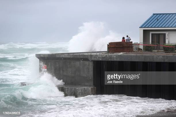 Wave crashes ashore next to a building on August 02, 2020 in Juno Beach, Florida. The storm is brushing along the east coast of Florida and tropical...