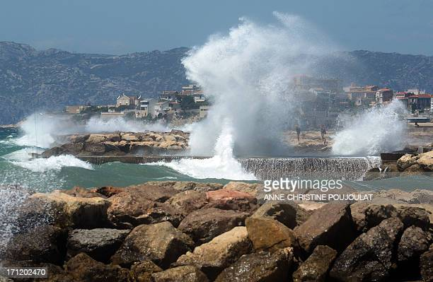 A wave crashes off Prado beach in Marseille southern France as a strong mistral wind blows on June 23 2013 AFP PHOTO / ANNECHRISTINE POUJOULAT