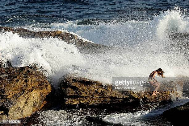 A wave crashes over a girl at a rock pool in Coogee on February 25 2016 in Sydney Australia The bureau of meteorology forecast temperatures over 40...