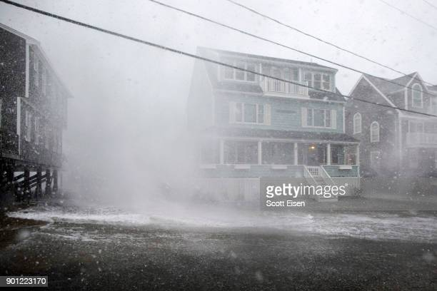 A wave crashes over a house on Lighthouse Rd as a massive winter storm begins to bear down on the region on January 4 2018 in Scituate Massachusetts...